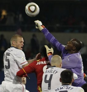 goalkeeper Kingson for Ghana clears ball from US