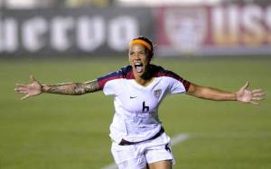 natasha kai u.s. women's soccer national team celebrates after a goal on the road to the 2008 Olympics
