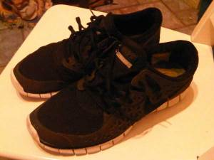 newer model of black Nike Free 5.0 ultralight running shoes