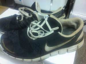 Old pair of Nike Free 5.0 ultralight running shoes